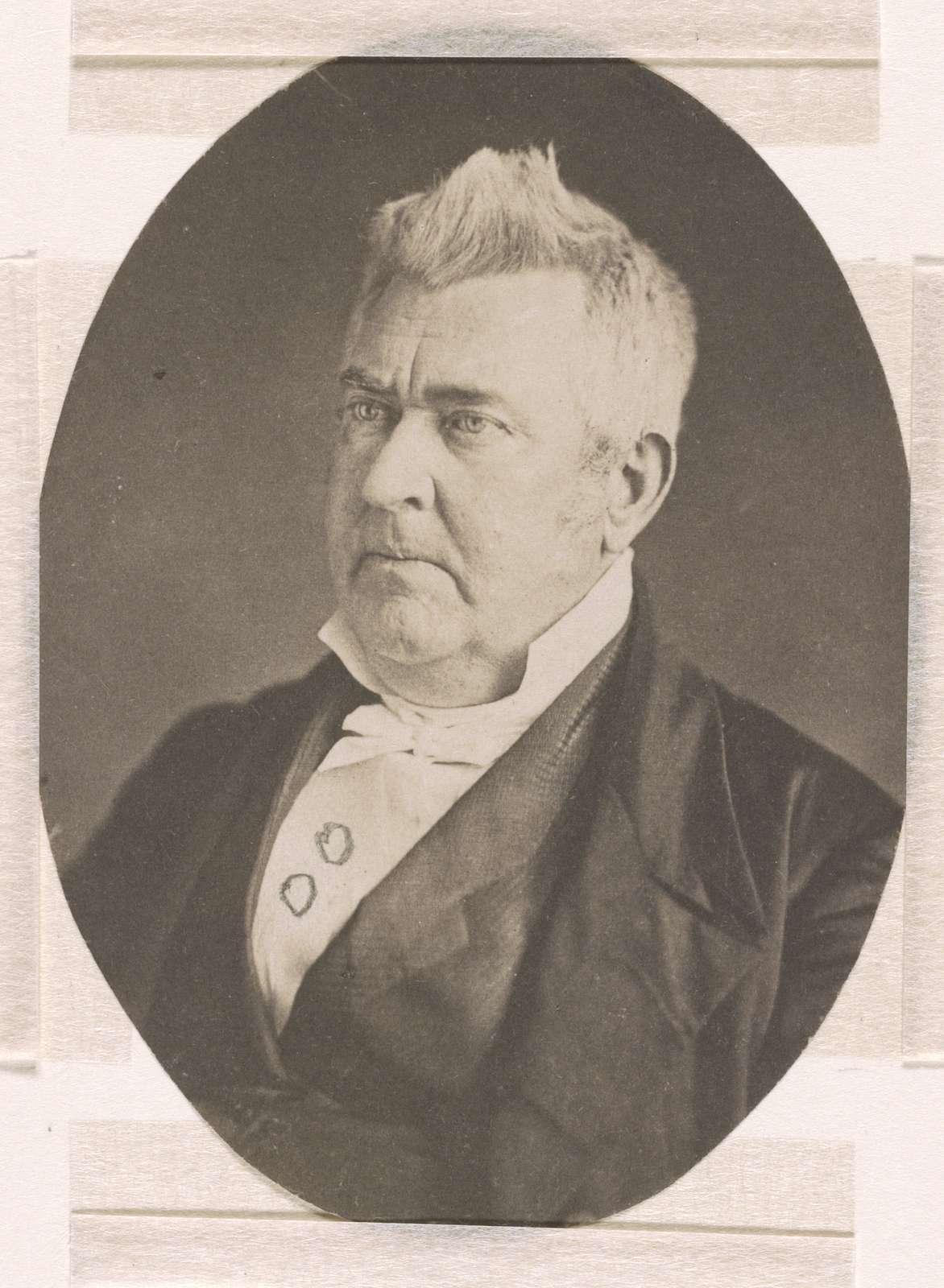 John M. Clayton, head-and-shoulders length studio portrait, facing left