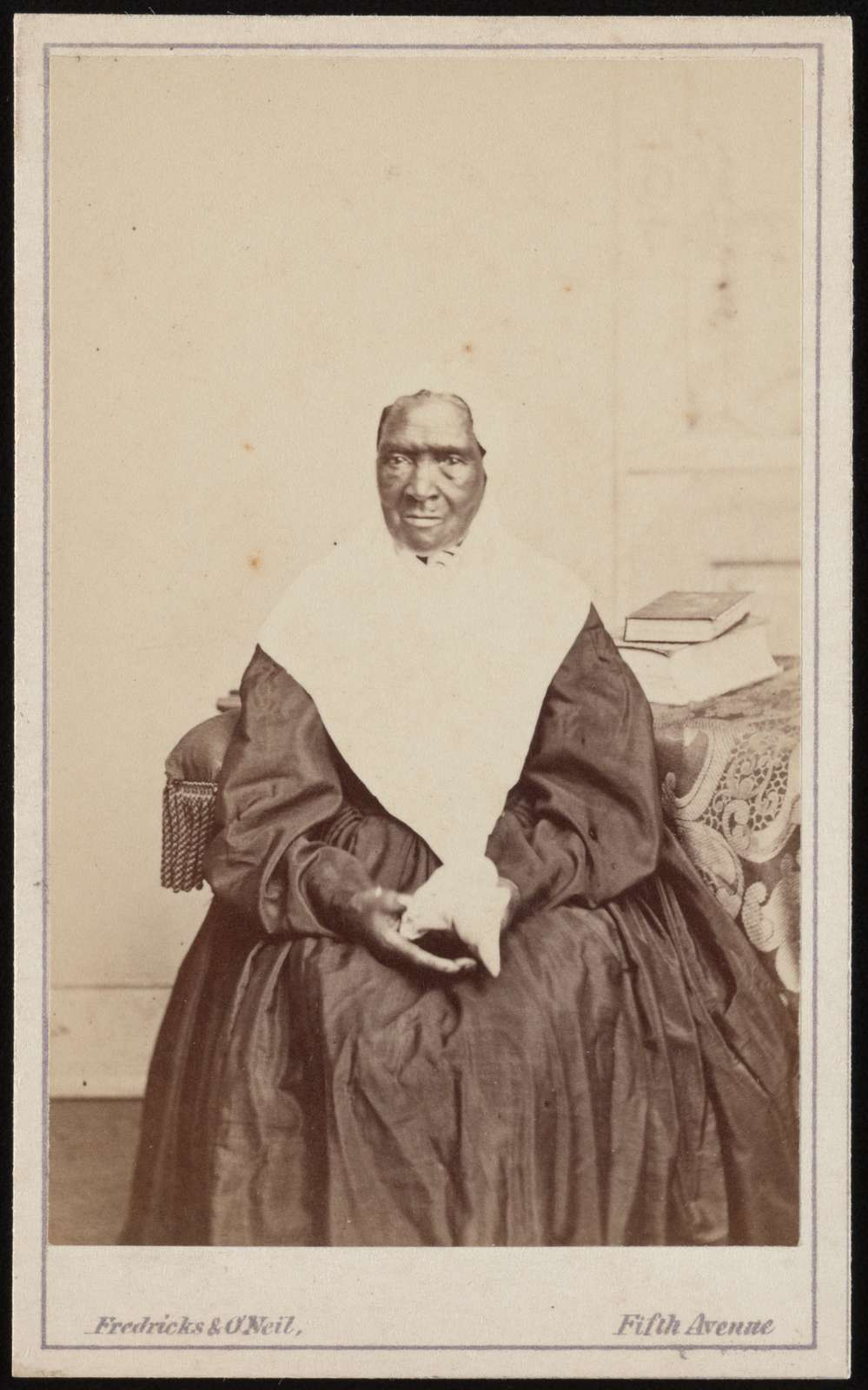 "African American woman identified as ""Aunt Fannie,"" servant of the Lott family Fredricks & O'Neil, Fifth Avenue Photograph Gallery, 179 Fifth Avenue, New York ; L.D. Fredricks ; John O'Neil"