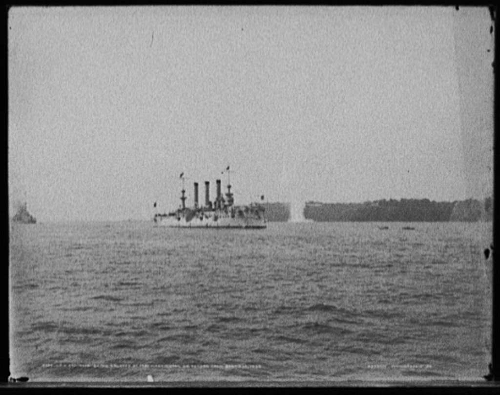 U.S.S. Brooklyn being saluted by Fort Washington on return from Santiago, 1898