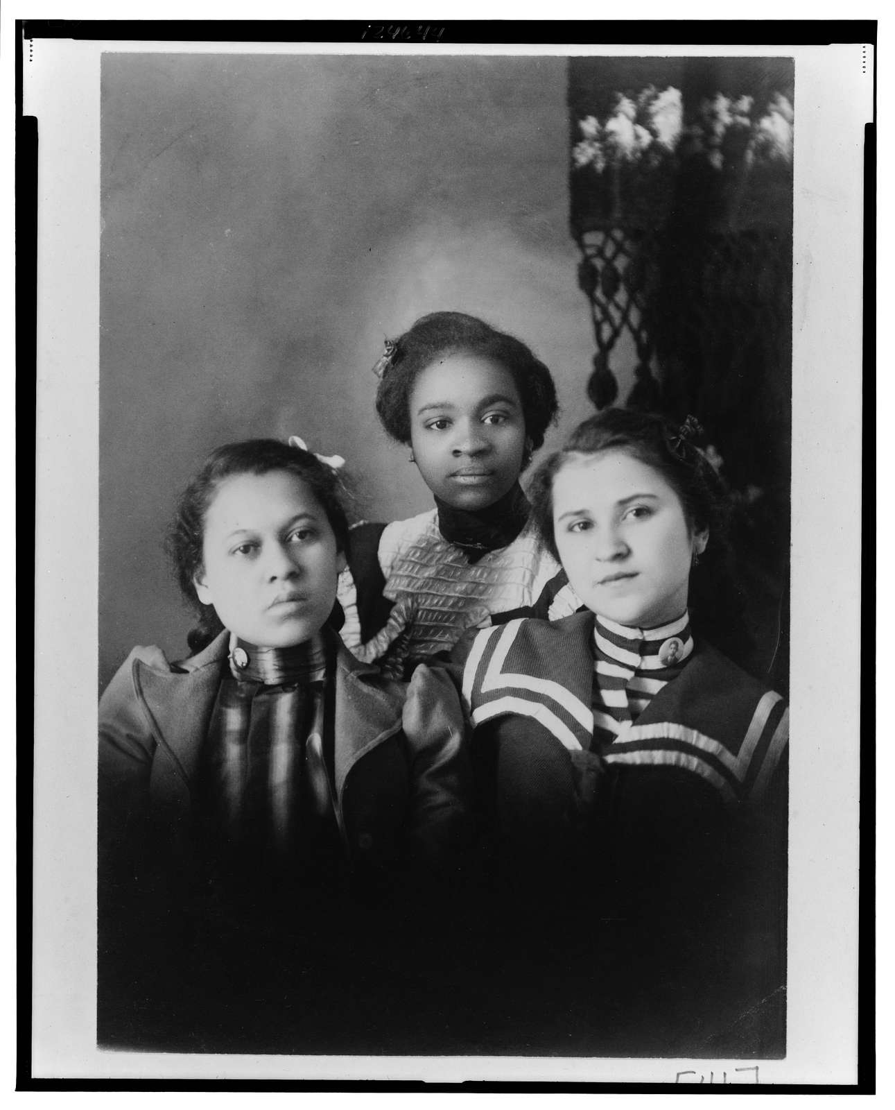 Three African American girls, head-and-shoulders portrait, facing front
