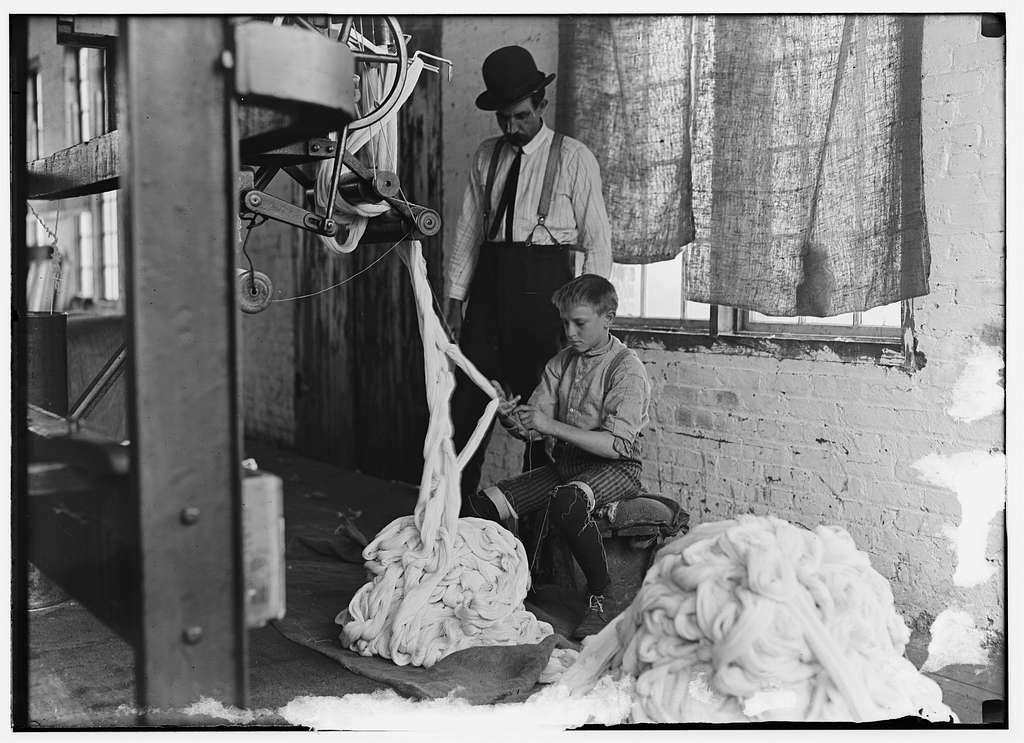 Boy at warping machine, Catawba Cotton Mill, Newton, N.C. Location: Newton, North Carolina