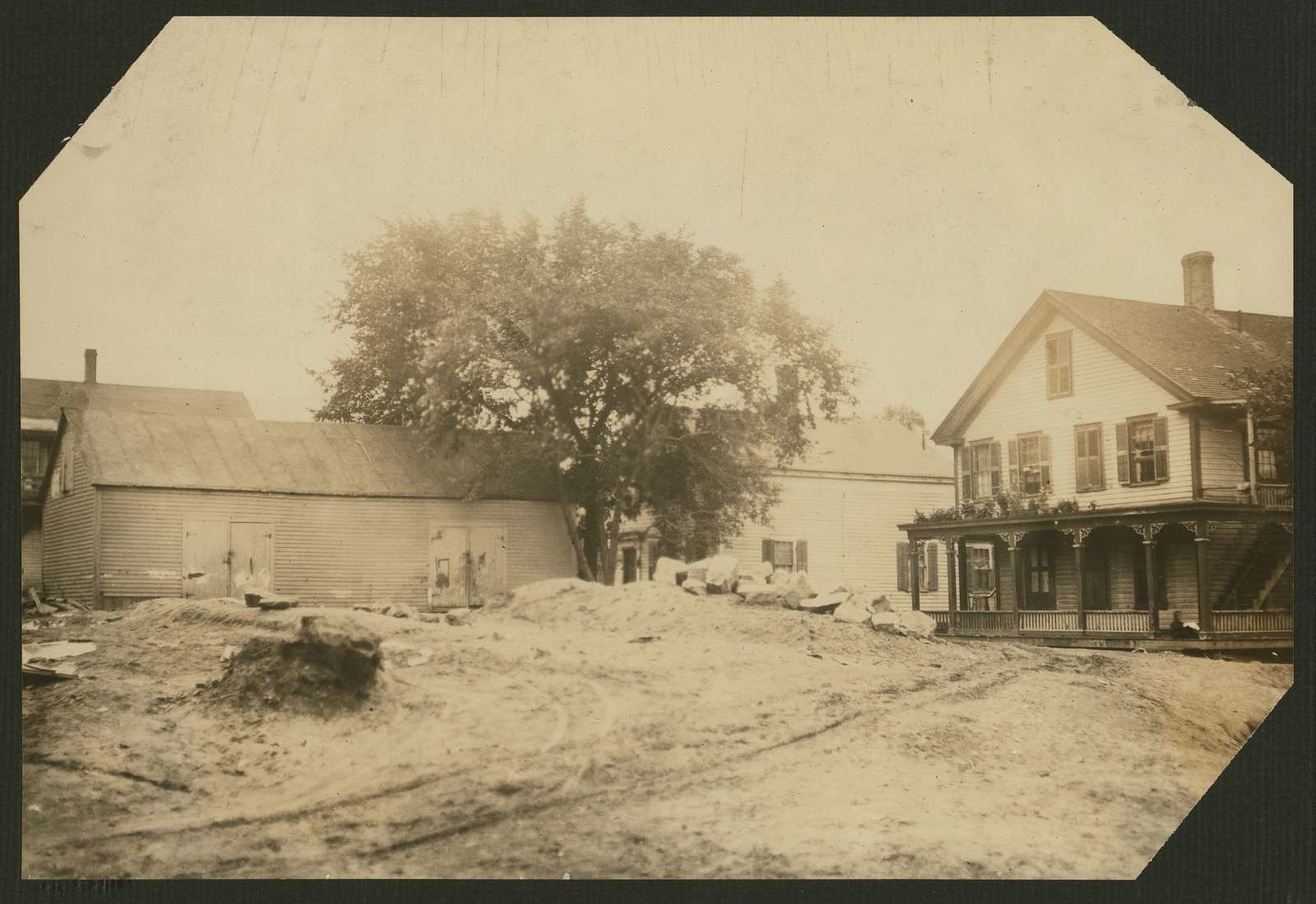 Cottage Street hovels down by the river in which a great deal of home work is done on suspenders. Location: Easthampton, Massachusetts