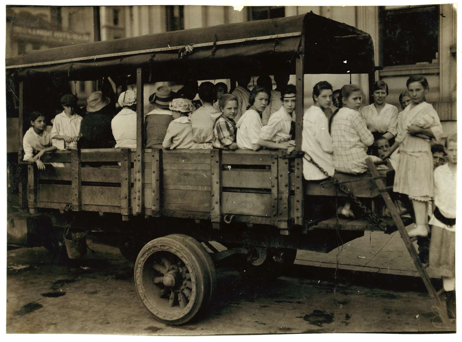 6:00 A.M. at Post Office Square. Truck load of tobacco workers bound for American Sumatra Tobacco Farm, South Windsor. They return about 7 P.M. Location: Hartford, Connecticut L.W. Hine