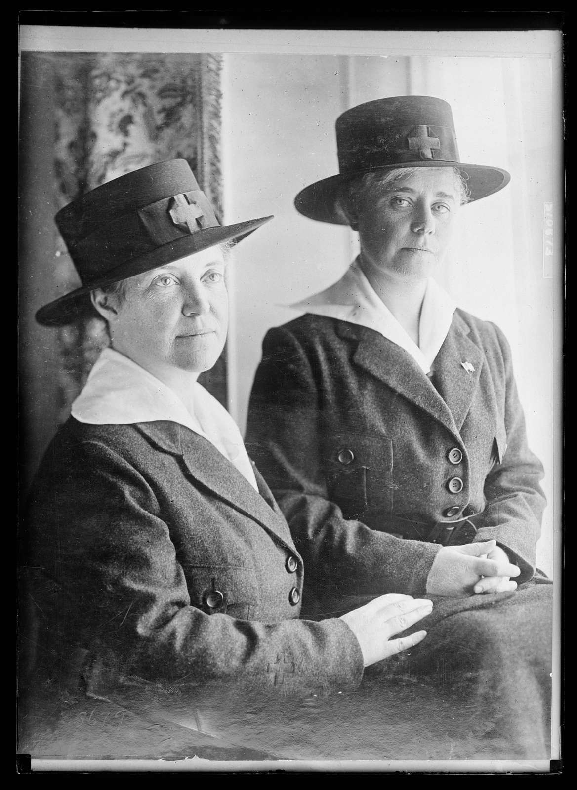 Left to right: the Misses Emma and Katherine Lansing, sisters of Sec. of State Robert Lansing, who are in France doing Red Cross work. This is the first photograph of them in uniform. They are going to establish aid stations for the soldiers at the front