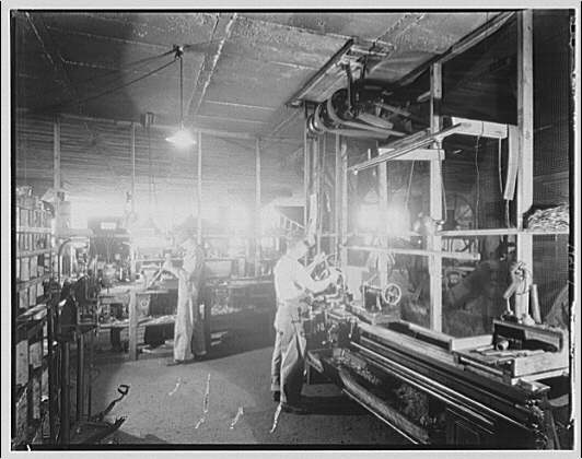 Griffith Consumers Co. Men in work room with machinery