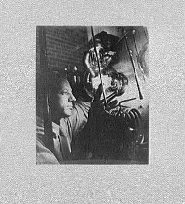 Miscellaneous subjects. Man examining machinery