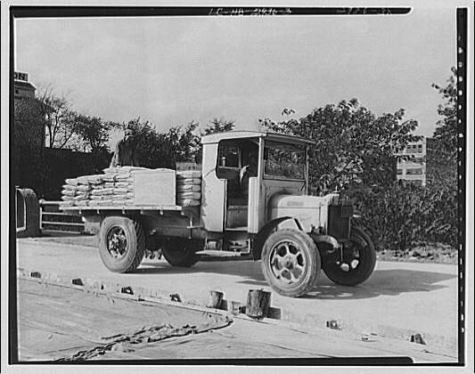 Miscellaneous subjects. Roslyn Steel and Cement truck unloading cement bags