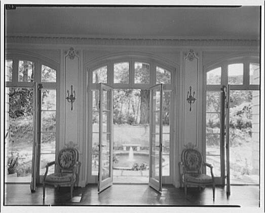 Mrs. Moran home at 2320 Bancroft. View through open French doors of Mrs. Moran's home to fountain