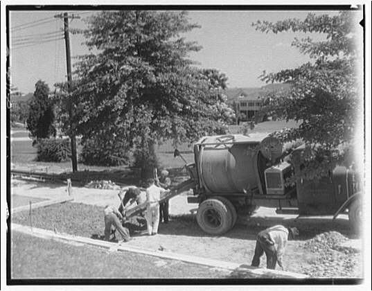 Street paving. Truck pouring cement II