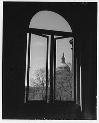 U.S. Capitol exteriors. Dome of U.S. Capitol through window of Library of Congress
