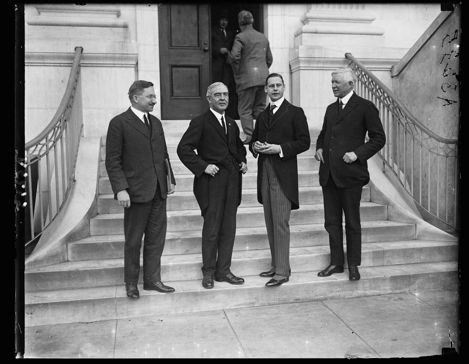Amer. Red Cross group. Left to right: James L. Fieser, Judge John B. Payne, Edgar Prochwile, and Col. Bickwell