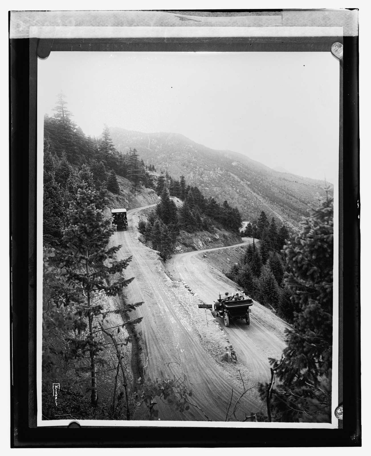 Mountain road with automobiles