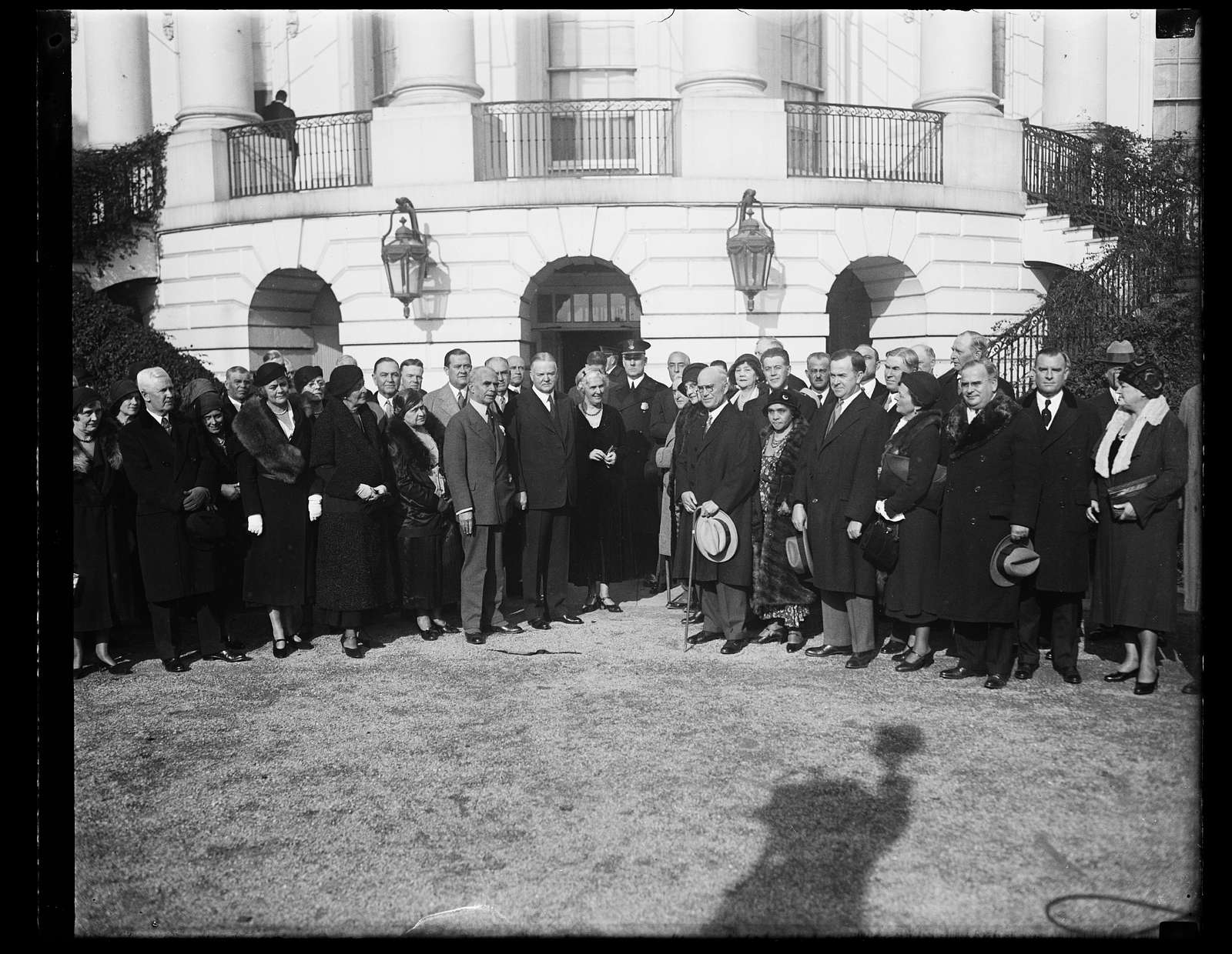 Herbert Hoover and Lou Hoover with group outside White House, Washington, D.C.