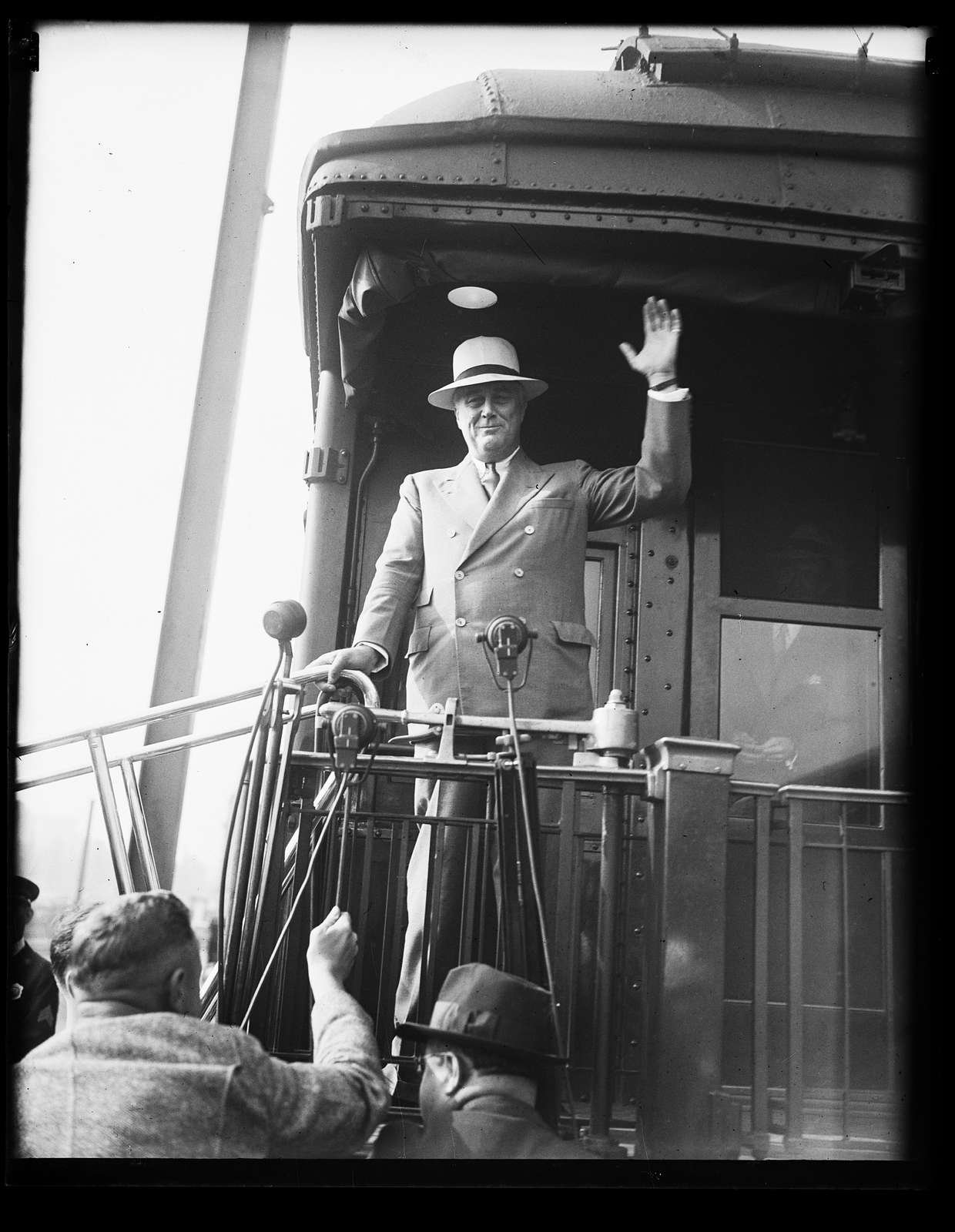 ROOSEVELT BACK FROM VACATION. RETURNING FROM HIS SUMMER WHITE HOUSE AT HYDE PARK, PRESIDENT ROOSEVELT IS CAPABLE OF SMILING DESPITE THE JUMBLED CONDITION OF HIS 'HOUSE OF LETTERS': NRA, AAA, ETC
