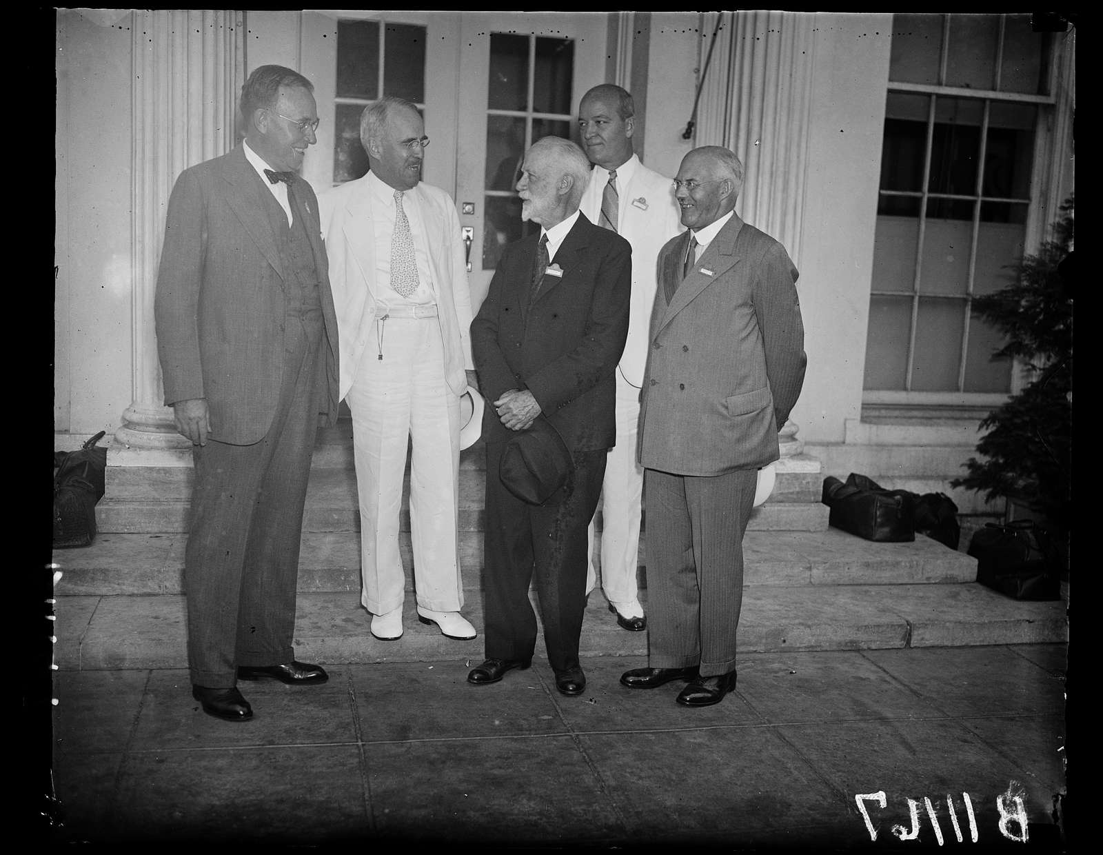 World power conferees visit Roosevelt, Washington, D.C., September 11. A group of delegates of the World Power Conference photographed outside the White House after they had paid a visit to President Roosevelt. From the left: F. L. Carlisle, Chairman of the Board of Consolidated Edison Co., of N.Y.; Morris L. Cooke, chief of the R.E.A.; W.F. Durand, Acting Chairman of the Conferences; Sir Harold Hartley, Chairman of the British Delegation; and in back; C.E. Stephens, Vice-President of the Westinghouse Co