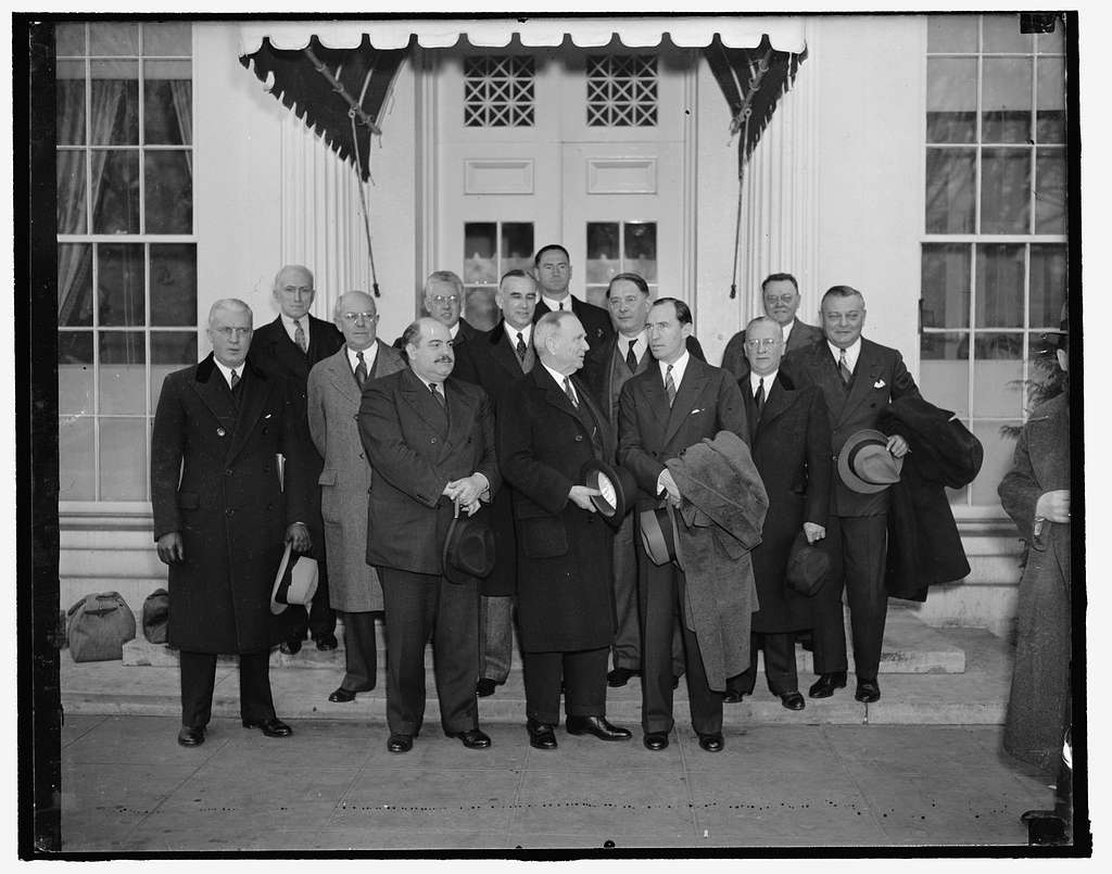 Little business men meet the President. Washington, D.C., Feb. 4. President Roosevelt today met in what was described as constructive discuss on with small business leaders. He was reported to believe that some of their recommendations could be carried into effect, shown as they left the White House after the conference. Left to right, front: R.P. Hastey, Chicago; O.L. Roach, Danville, VA.; Leslie E. Sanders, Orlando, Fla.; Secretary of Commerce Daniel Roper; Bernard F. McLain, Dallas, Tex.; Howard D. North, Cleveland; Wallace D. Kimball, New York City. In the rear, left to right: D.E. McAvoy, New York City; Joseph D. Kleckner, Chicago; Asst. Sec. of Commerce Ernest Draper; W.C. Tinsley, Tampa, Fla.; James Daly, Columbus, OH; W.K. Gunter, Gaffney, N.C., 2438