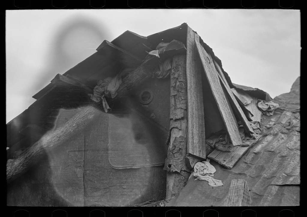 Detail of construction of roof of house of white tenant family. Notice the rags stuffed in under the shingles to keep out cold and rain. McIntosh County, Oklahoma