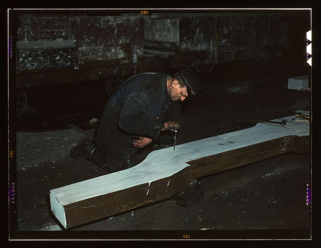 Section of a locomotive frame, which will be welded to replace a broken locomotive frame, Chicago, Ill. Workman is indicating what place must be cut. At the 40th Street shop of C&NWRR i.e. Chicago and North Western railroad