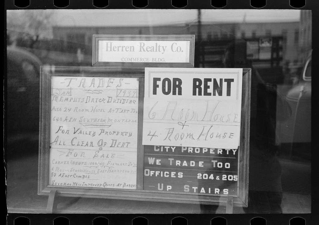 Signs in real estate window, Harlingen, Texas