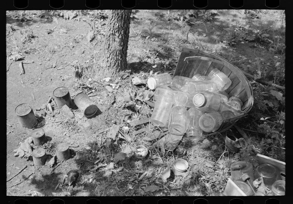 Tin cans and glass jars near camp of agricultural day laborers camped near Spiro. Sequoyah County, Oklahoma