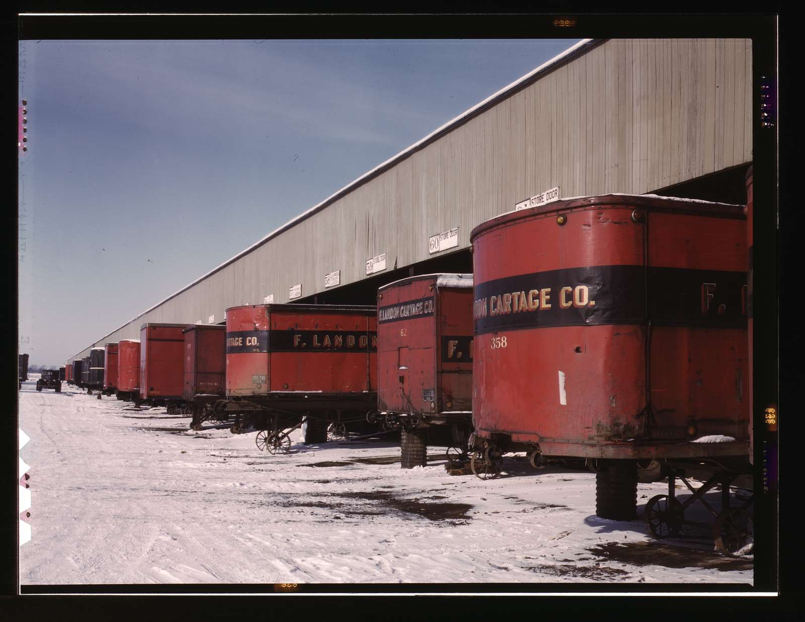 Truck trailers line up at a freight house to load and unload goods from the Chicago and Northwestern i.e. North Western railroad, Chicago, Ill