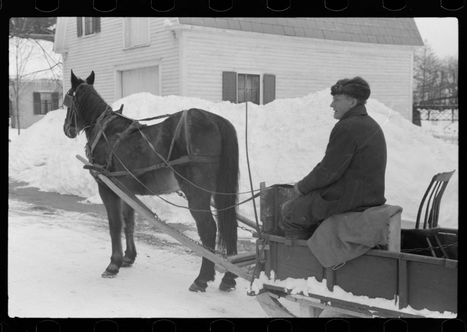 Untitled photo, possibly related to: Mr. G.W. Clarke, who is seventy-one years old and has always lived in Vermont brings his butter to town on Saturday to sell to his customers in Woodstock, Vermont