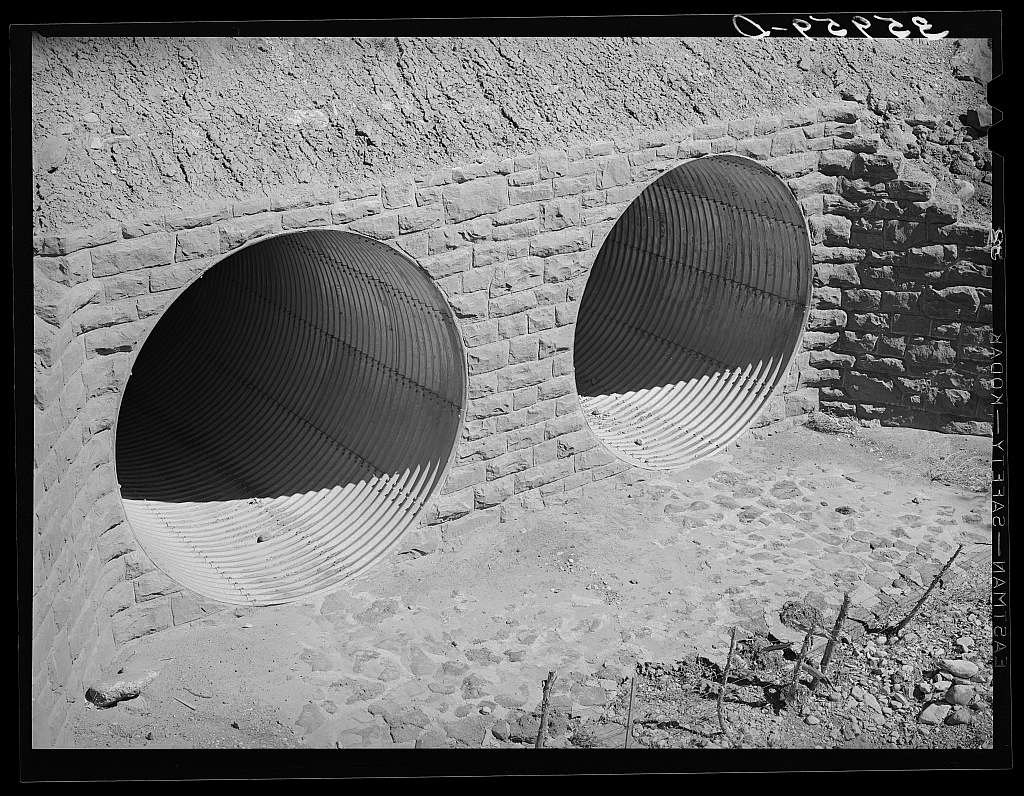 Conduits under the highway to carry off flood waters, thus protecting the highway. U.S. 60, Navajo County, Arizona