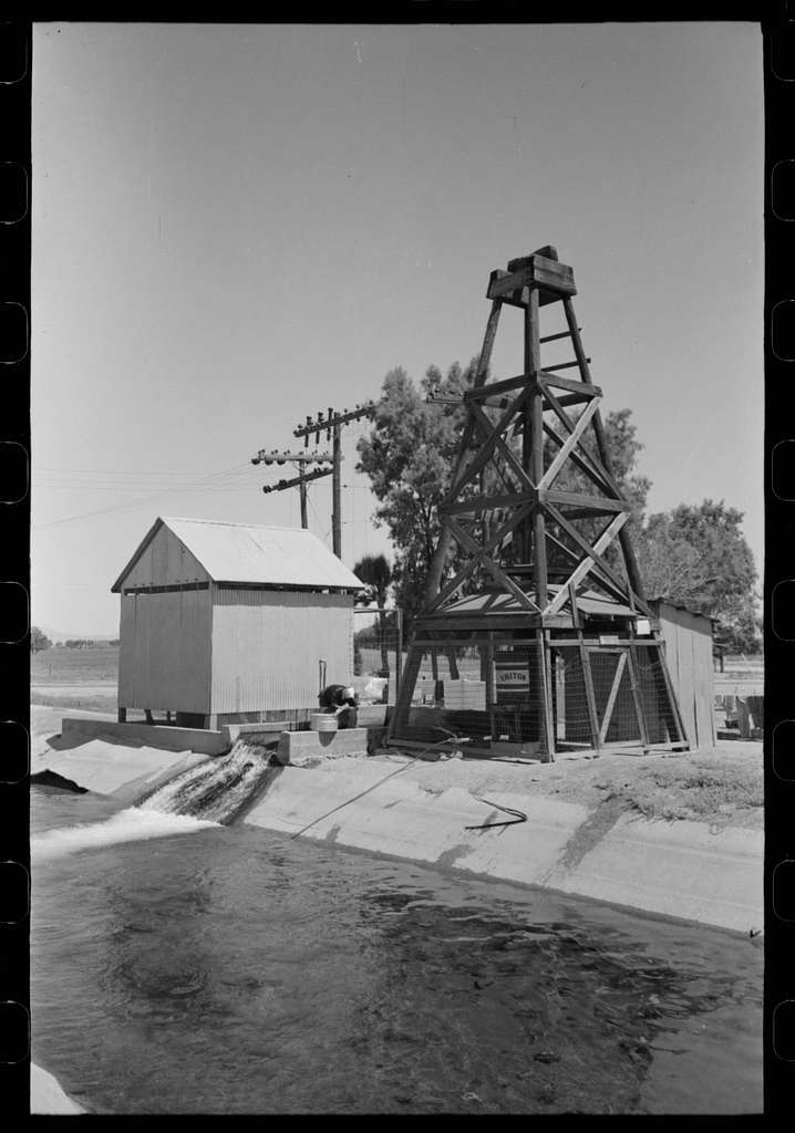 Deep well and pump house at side of irrigation ditch, Maricopa County, Arizona