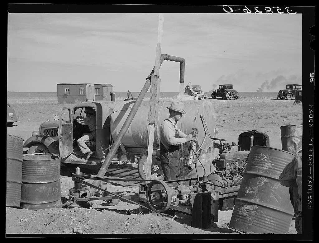 Filling tank with water to be used in road construction. Gaines County, Texas