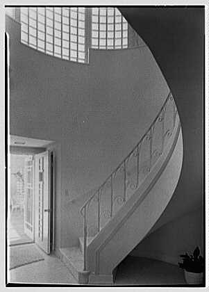 Herman Wall, residence at 245 E. Rivo Alta Dr., Miami Beach, Florida. Staircase and front door