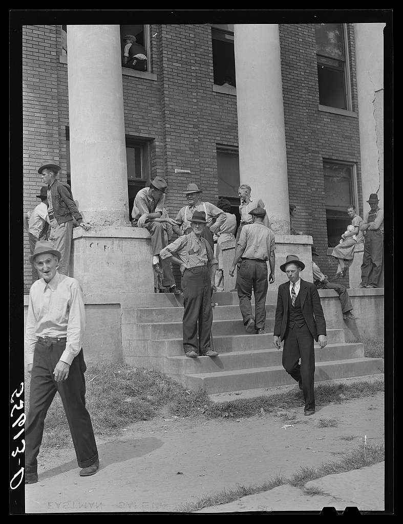 Mountain people and farmers exchanging news and greetings on court day on the steps of the courthouse. Campton, Wolfe County, Kentucky