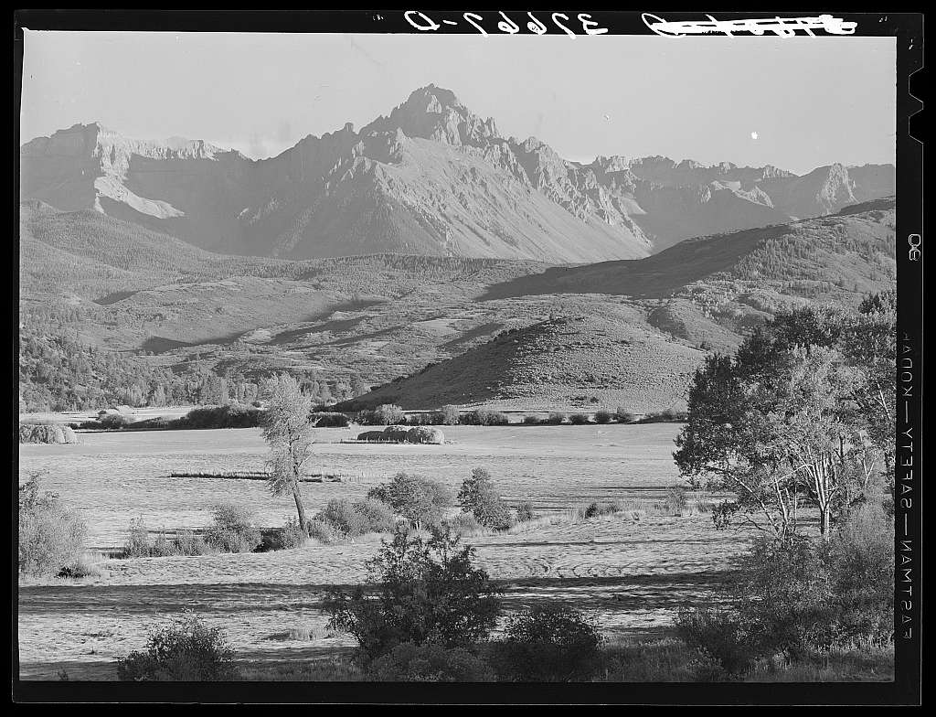 Mountain valley with Mount Sneffels in background. Ouray County, Colorado