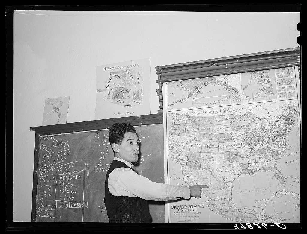 School teacher in grade school teaching geography. Concho, Arizona