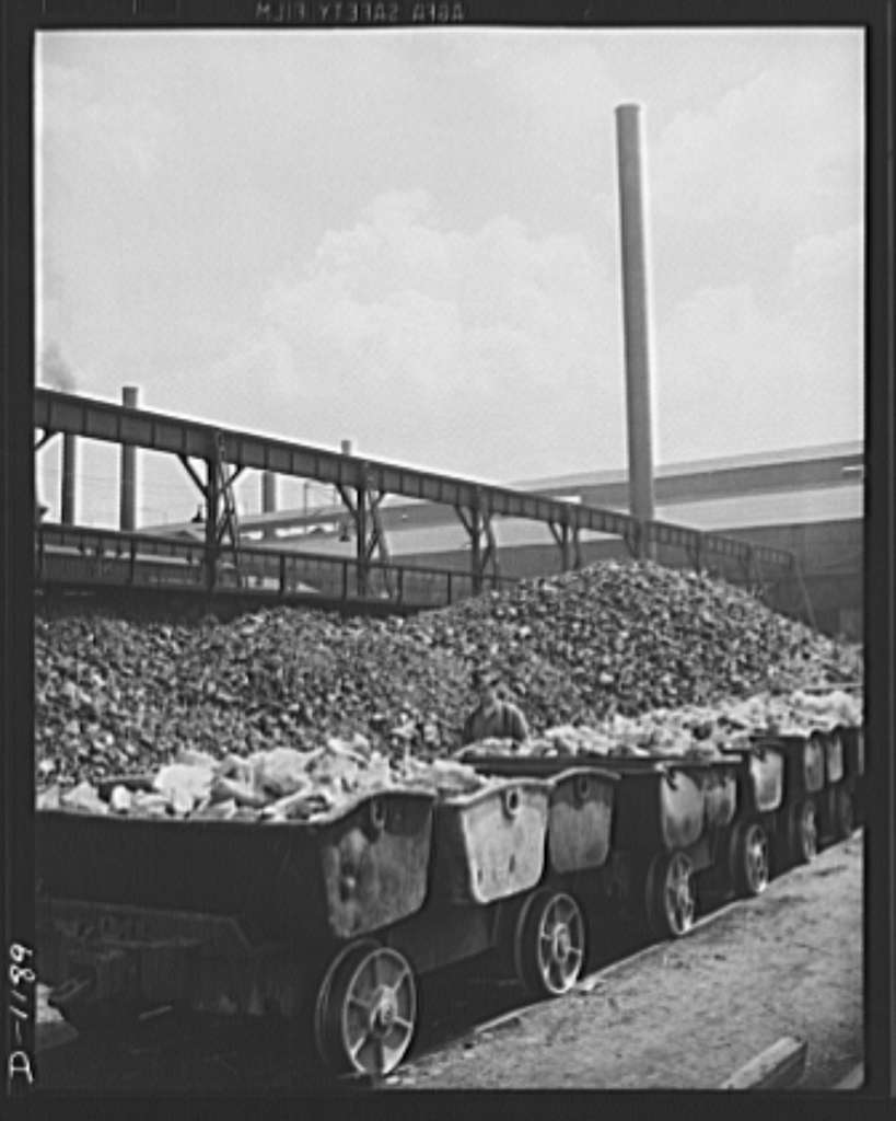 Steel manufacture, Allegheny-Ludlum. Here is a row of charging boxes loaded with limestone, the main ingrediant in the production of quality steel. These boxes will shortly dump their loads into open hearth furnaces