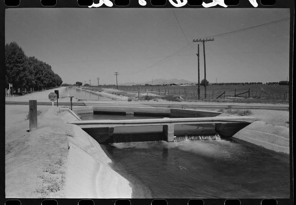 Untitled photo, possibly related to: Irrigation ditch fed by water from deep-driven wells, Maricopa County, Arizona