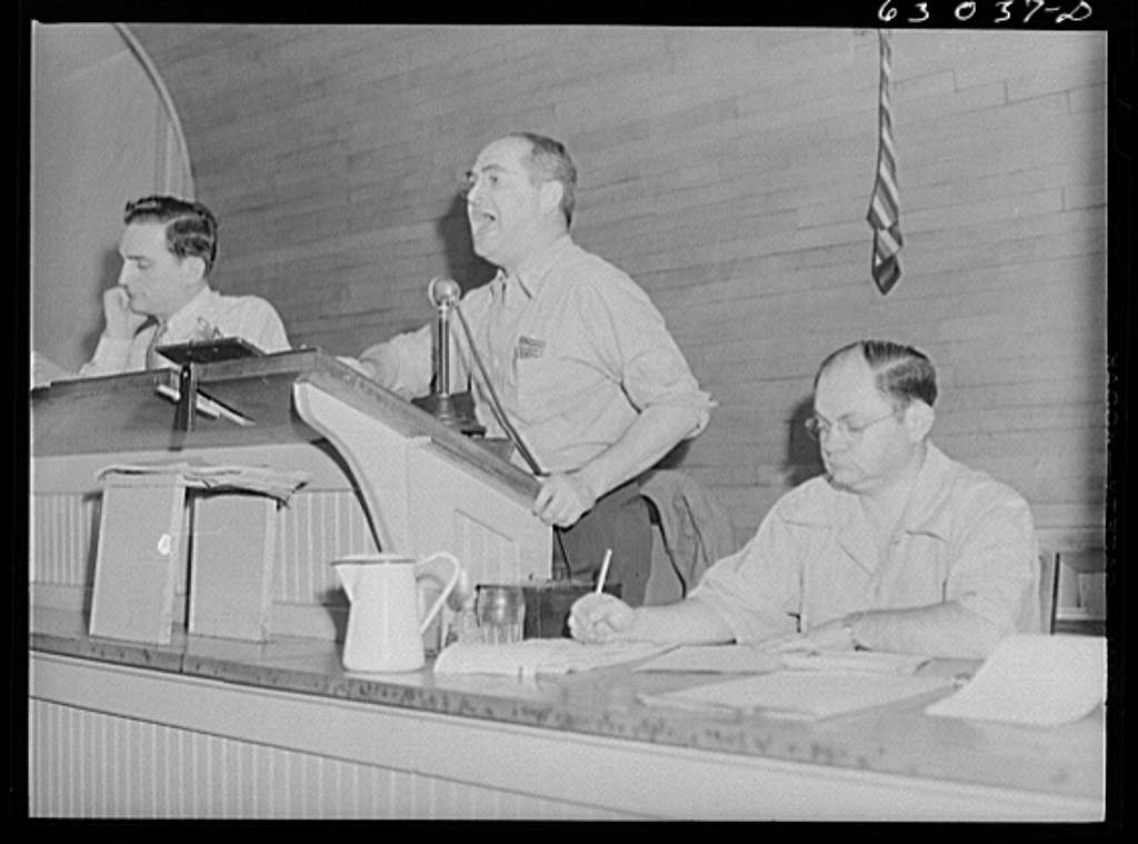 Auctioneer selling shipment of fruit at fruit terminal auction room. Chicago, Illinois