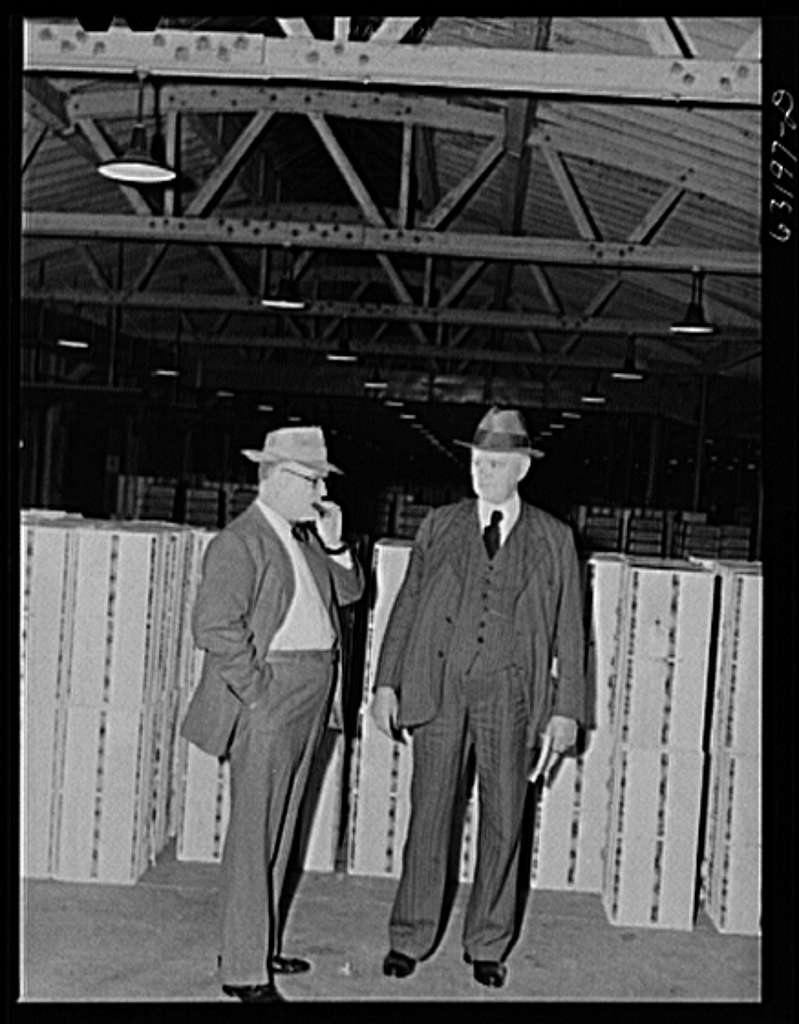 Commission merchants before early morning auction begins. Fruit terminal warehouse. Chicago, Illinois
