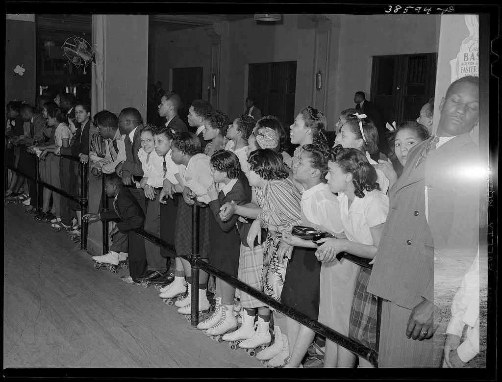 Crowds watching rollerskating exhibition. Chicago, Illinois