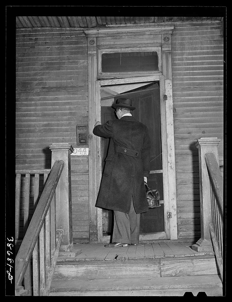 Doctor entering home of relief family. Chicago, Illinois