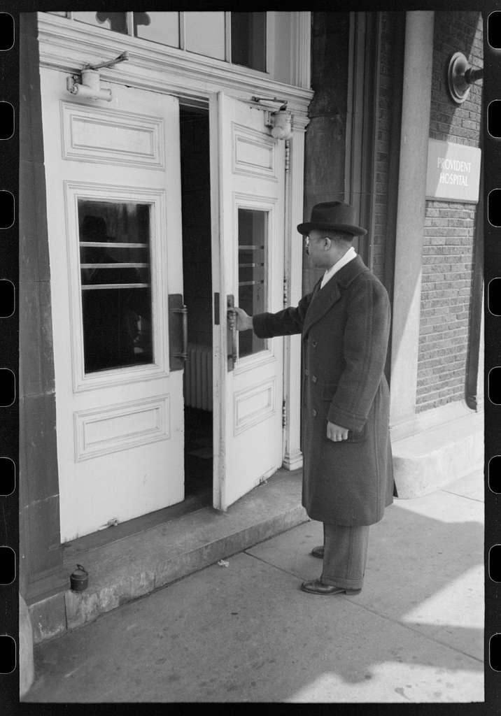 Doctor entering Provident Hospital, South Side of Chicago, Illinois