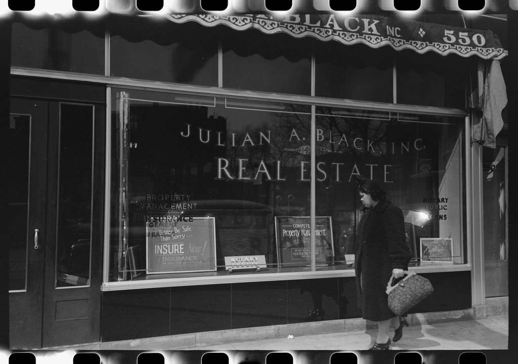Front of real estate office in Negro section of Chicago, Illinois
