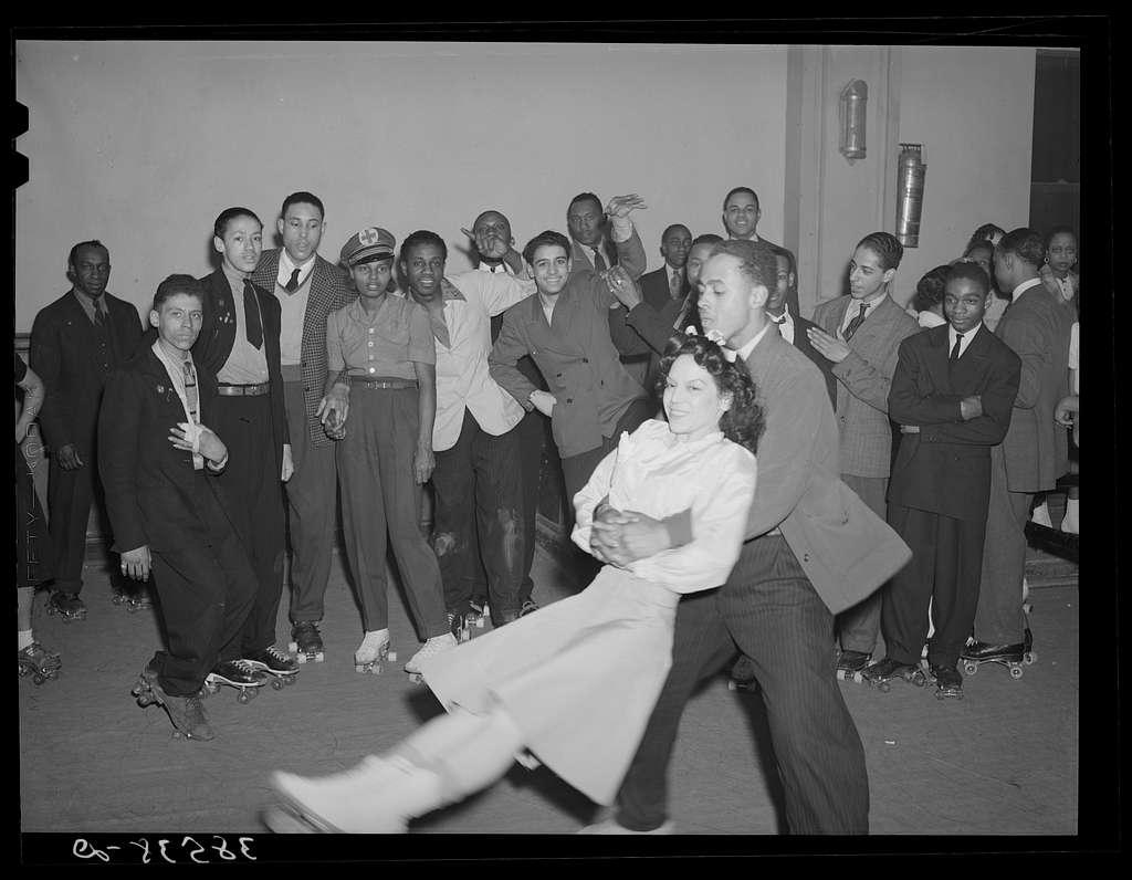 Negro swinging his girl on roller skates. Savoy Ballroom, Chicago, Illinois