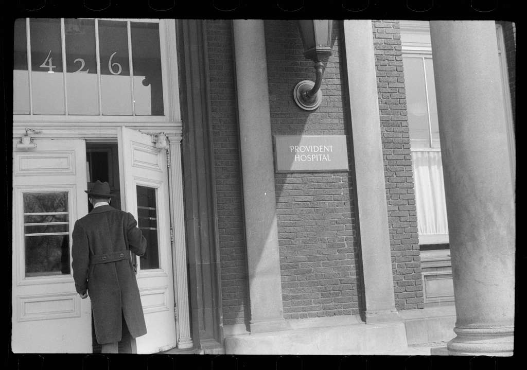 Untitled photo, possibly related to: Staff doctor entering Provident Hospital, Chicago, Illinois