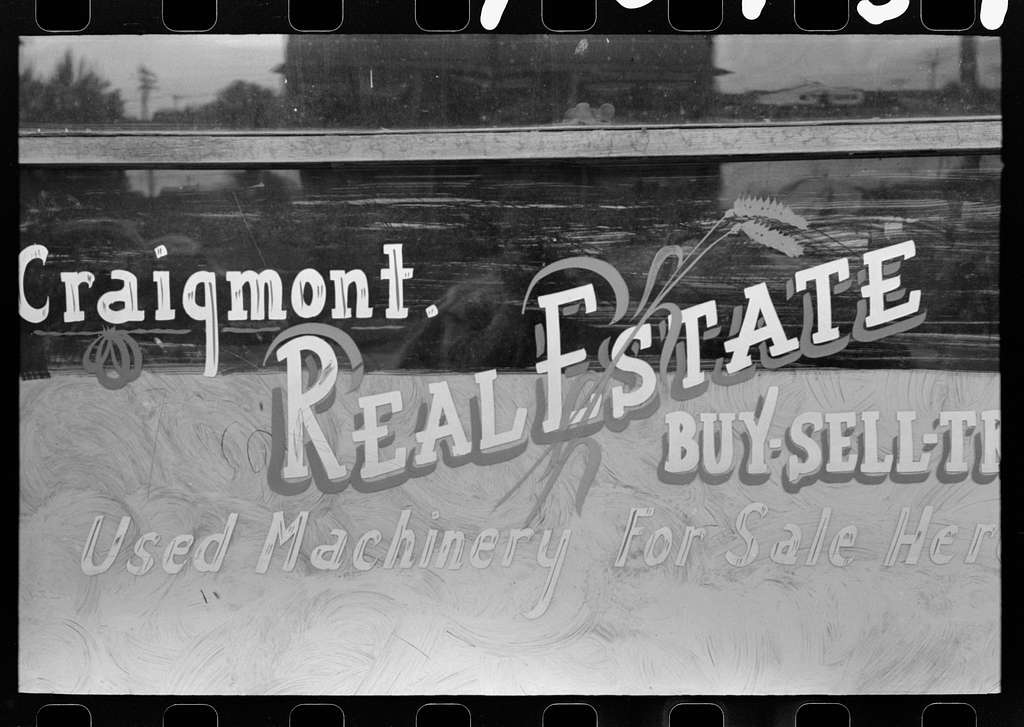 Walla Walla County, Washington. A real estate office advertising used farm machinery for sale