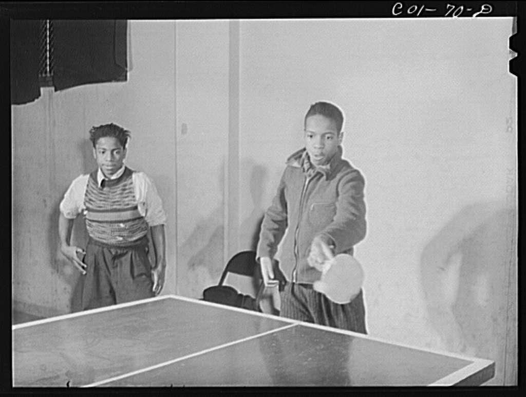 A game of ping-pong in the recreation hall at the community center. Ida B. Wells Housing Project, Chicago, Illinois