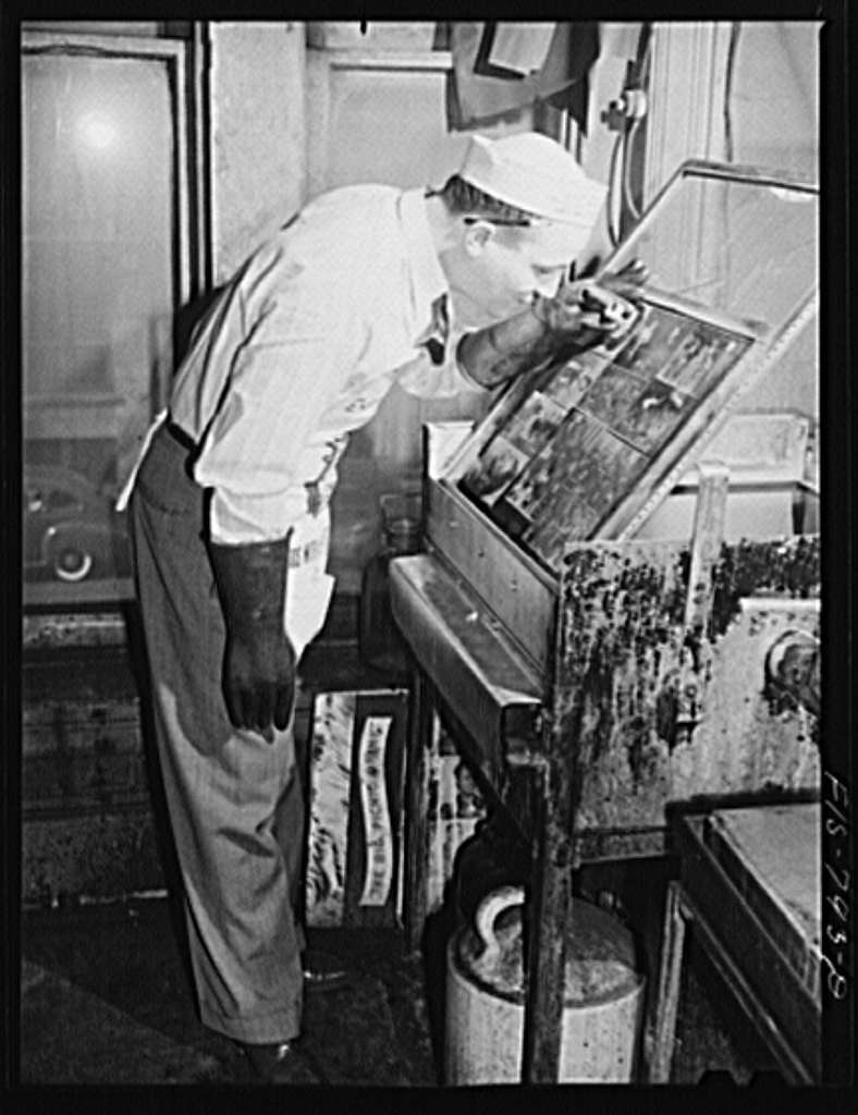 Chicago, Illinois. Engraver on the Chicago Defender, a Negro newspaper