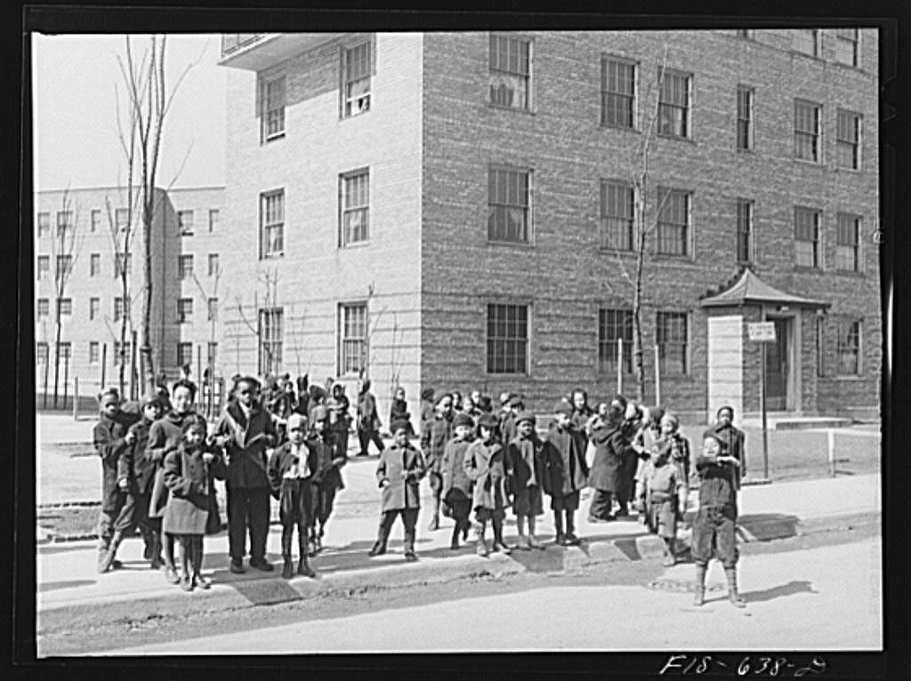 Chicago, Illinois. Ida B. Wells Housing Project. Children lining up to go to kindergarten class at the community center