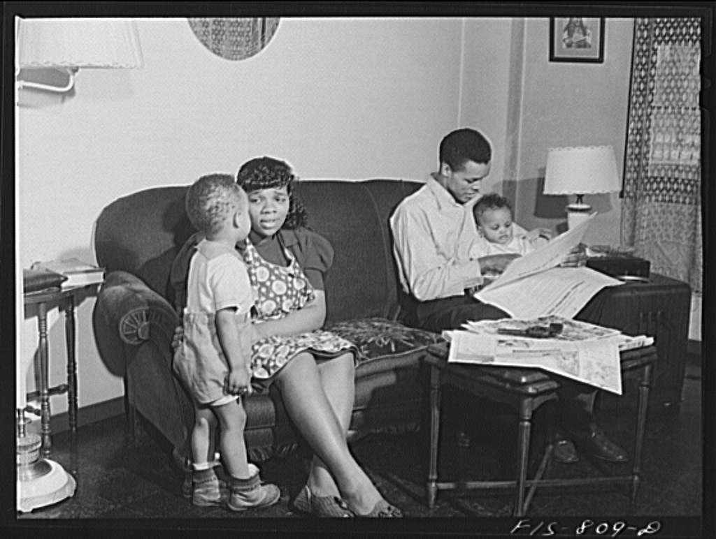 Chicago, Illinois. Ida B. Wells Housing Project. Family of Mr. Edward Vaughn, living in one of the apartments. Mr. Vaughn is doing work for the War Department
