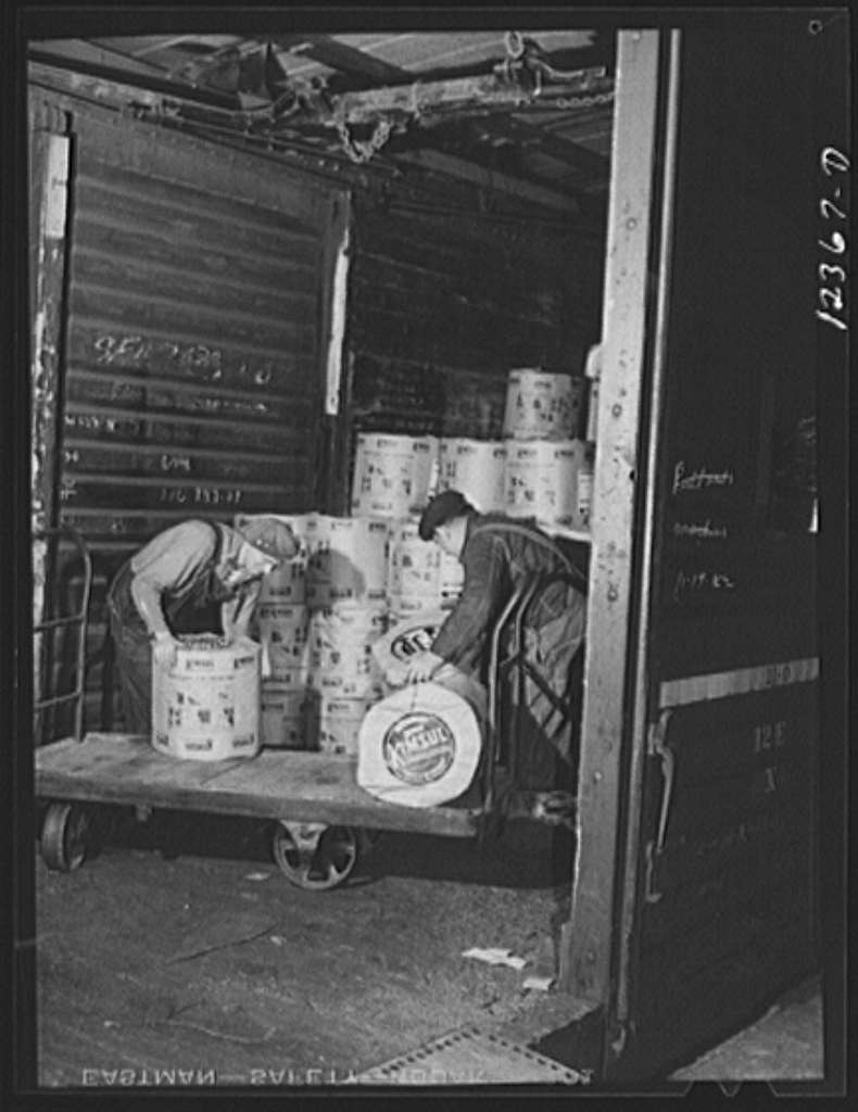 Chicago, Illinois. Loading a car with a shipment of insulating material at a Chicago and Northwestern Railroad yard