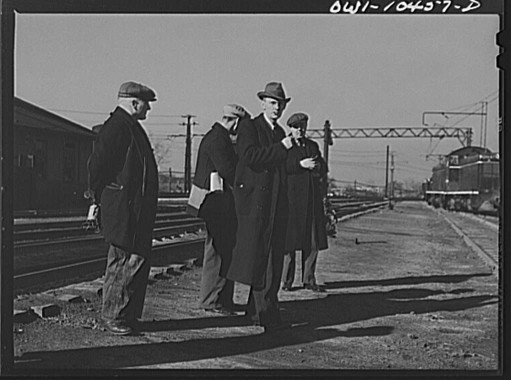 Chicago, Illinois. Men arriving for work at an Illinois Central Railroad yard
